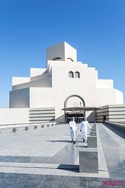 Qatar, Doha. Museum of islamic art with two arabs