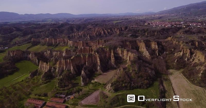 Aerial, Le Balze del Valdarno, giant ancient hills made of sand, clay, argil and gravel situated in Tuscany in Italy