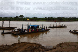 Truck on raft crossing the River Mamoré between San Ignacio de Moxos and Trinidad , Beni , Bolivia