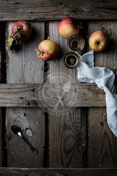 Apples and coffee on rustic wooden table