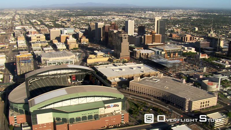 Flight past downtown Phoenix and Chase Field with roof retracted.