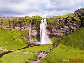 Aerial drone view of Seljalandsfoss waterfall with rainbow, Iceland