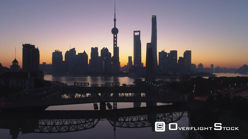 Panoramic Shanghai Skyline at Dawn. Lujiazui Financial District and Huangpu River. China. Aerial View. Drone is Flying Upward. Establishing Shot.