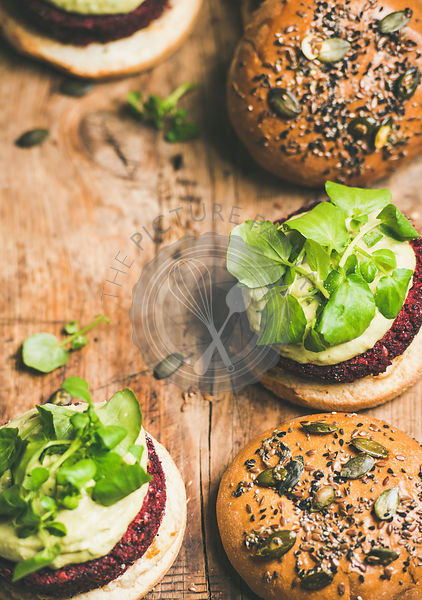 Healthy vegan burgers with beetroot patties and sprouts