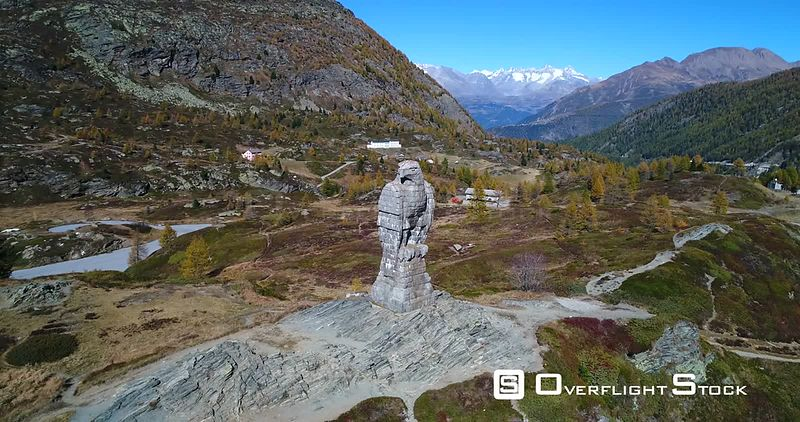Stone Statue, 4k Aerial Sideway View of a Eagle Statue Monument, on the Top of Simplon Pass, Sunny Autumn Evening, Valais, Switzerland