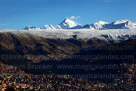 La Paz city outskirts and Mt Huayna Potosí with fresh winter snowfall on altiplano, Bolivia