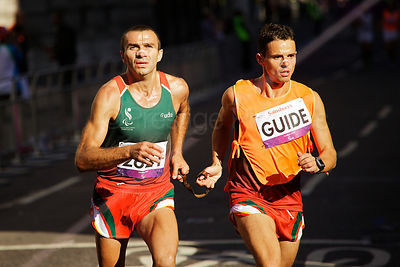 Joaquim Machado of Portugal  running though the City of London in the T12 London 2012 Marathon