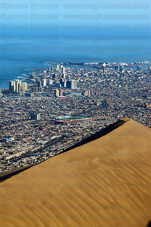 Aerial view of Iquique and huge sand dune , Region I , Chile