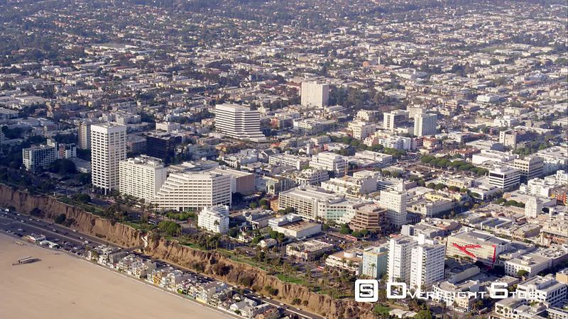 Aerial View Of Hotels Along Ocean Blvd In Santa Monica, Pacific Coast Highway And Beach, RED R3D 4k California