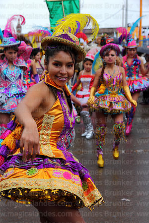 Chinita dancing the morenada at Virgen de la Candelaria festival, Puno, Peru