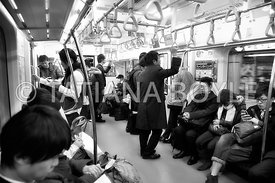 Commuters in Tokyo subway train