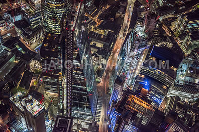 "3845. Night aerial view over the 737 ft tall Leadenhall Building, known as the ""The Cheesegrater"" and designed by Rogers Stirk Harbour + Partners, the building has recently been sold for £1.5 billion. On the oopposite side of the road you can see the construction of one of London's newest tall buildings the the Scalpel at 52 Lime Street."
