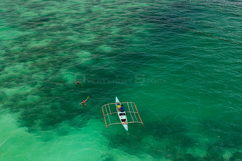 Aerial view of farmers on outrigger boat working at a seaweed farm growing agar-agar for processing into carageenan (gelatinous extracts used as binder for food or product) Philippines, May 2009