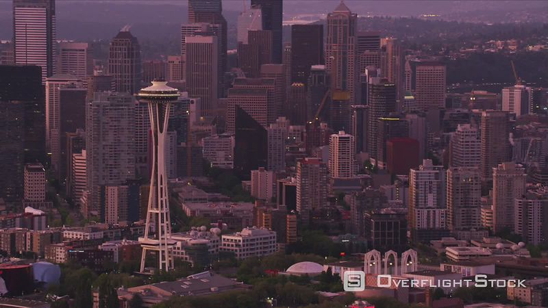 Seattle, Washington Aerial view of Space Needle and city buildings at dawn.  Shot with Cineflex and RED EpicW Helium.