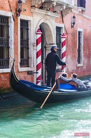 Gondola with tourists on a canal, Venice, Italy