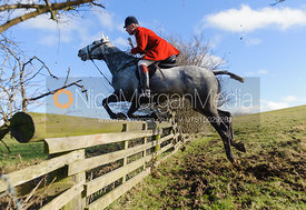 Andrew Osborne MFH jumping a hunt jump - The Cottesmore at Furze Hill.