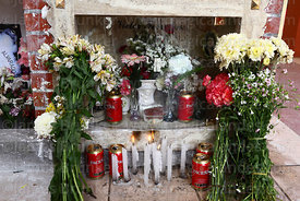Tomb decorated with candles, flowers and beer cans for Todos Santos festival, La Paz, Bolivia