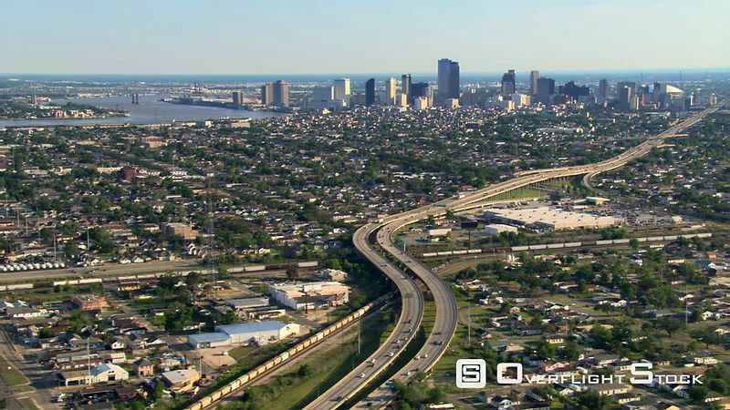 Wide aerial view toward distant New Orleans sky