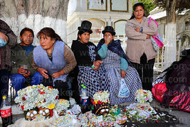 Aymara women with their skulls in cemetery, Ñatitas festival, La Paz, Bolivia