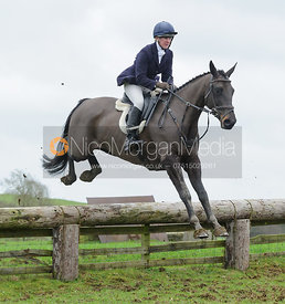 Nicola Wilson jumping a hunt jump at Deane Bank Farm