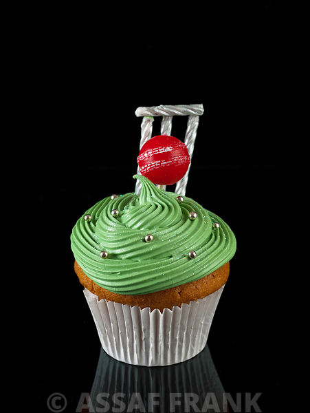 Cupcake with cricket ball shaped candle