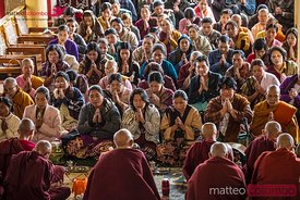 Local women praying with buddhist monks, Myanmar