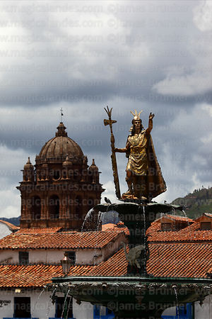 Statue of the Inca Pachacuti Inca Yupanqui or Pachacutec on fountain and La Merced church tower, Cusco, Peru