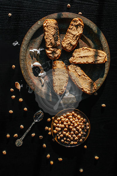 Homemade hummus on a black background
