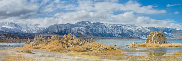Panoramic view with mounds of the natural formation of tufa (calcium carbonate) at Mono Lake with the Sierra Nevada mountains in California, USA.