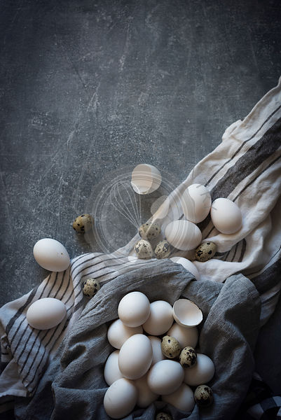 White eggs in a grey cloth linen