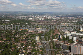 Manchester aerial photograph of the route of the M 602 motorway running parallel with the main railway line into Manchester showing the City and the hills in the distance