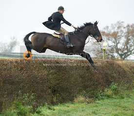 John Knowles jumping a big hedge