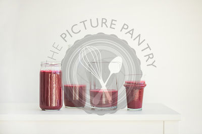 Fresh morning beetroot smoothie or juice in glasses, white background, copy space