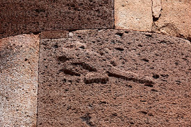 "Detail of lizard carving on the ""lizard chulpa"", a cut stone Inca period chulpa / burial tower, Sillustani, Peru"