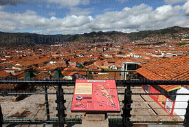 View over city with sign showing how Cusco was supposedly built in the shape of a puma, Peru
