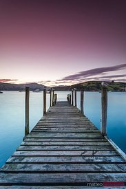 Sunset over pier, Akaroa, Christchurch, New Zealand