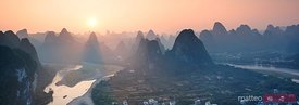 Panoramic sunset over Li river and karst mountains, China