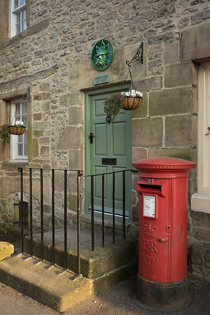 Winster cottage with red post box