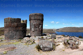 Cut stone Inca period chulpas / burial towers and Lake Umayo, Sillustani, Peru