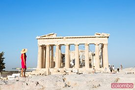 Woman looking at the famous Parthenon temple on the Acropolis, Athens, Greece