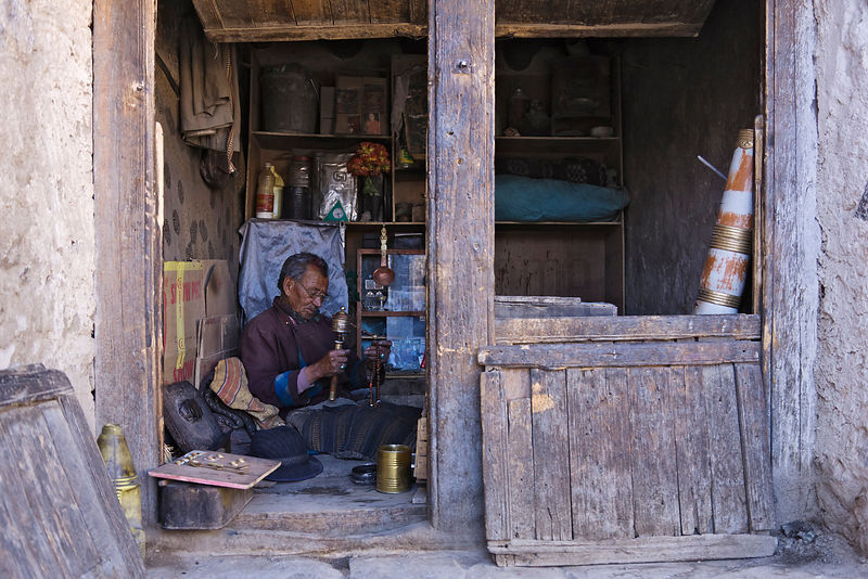 Shopkeeper with Prayer Wheel