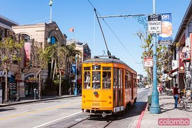Orange vintage tram in the streets of San Francisco, USA