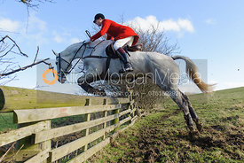Nicholas Leeming MFH jumping a hunt jump - The Cottesmore at Furze Hill.