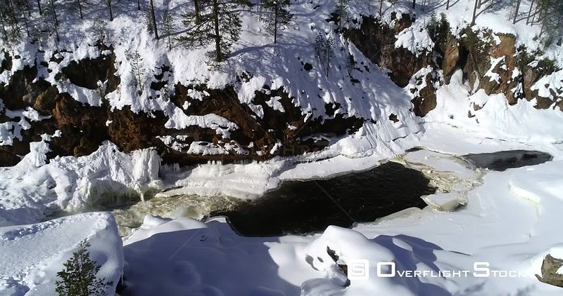 Lapland rapids, aerial rising drone view of kiutakongas rapid, in Oulanka national park, on a sunny, winter day, in Kuusamo, PohjoisPohjanmaa, Finland