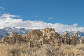 Mounds of the natural formation of tufa (calcium carbonate) with the Sierra Nevada mountains in the background at Mono Lake in California, USA.