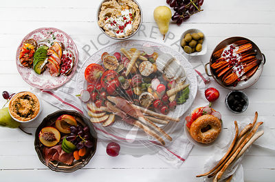Variety of snacks prepared for picnic wine summer party