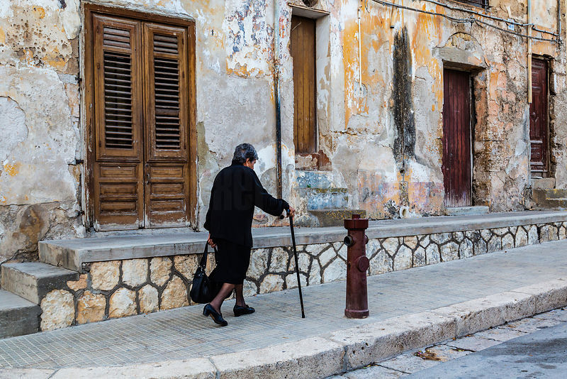Woman with a Cane Walking to Church