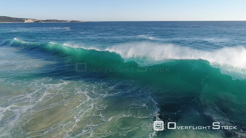 Huge waves crashing on a beach in Perth Australia
