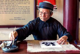 Old vietnamese man writing ancient characters, Hanoi