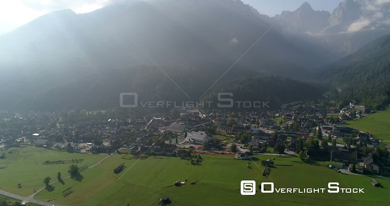 Alpine town, C4K aerial drone view of the Kranjska Gora town and Trigolov national park, on a sunny summer day, in the Julian alps, Slovenia